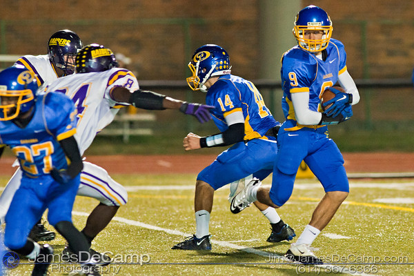 Gahanna High School's #14 Tanner Zwelling hands off the ball to #9 Julian Lowe who runs the ball in for a touchdown in the second quarter of play at Gahanna High School Friday night October 22, 2010.(© James D. DeCamp / http://www.OhioPhotojournalist.com / 614-367-6366)