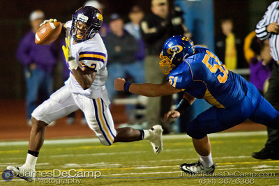 Gahanna High School's #51 Evan Bergenstein just misses a tackle on   Reynoldsburg High School's #2 Chris Lee in the second quarter of play at Gahanna High School Friday night October 22, 2010.(© James D. DeCamp / http://www.OhioPhotojournalist.com / 614-367-6366)