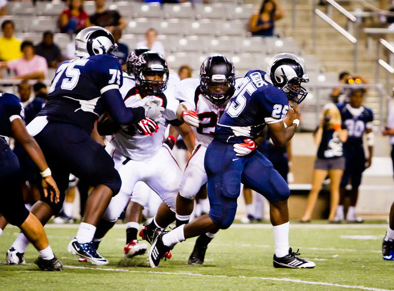 "Game: Langham Creek Lobos vs Cy-Ridge Rams at Berry Center on Thursday, September 8, 2011<br /> <br /> Photo by Greg Vaughn.  Available at <a href=""http://www.gregvphotography.com"">http://www.gregvphotography.com</a>"