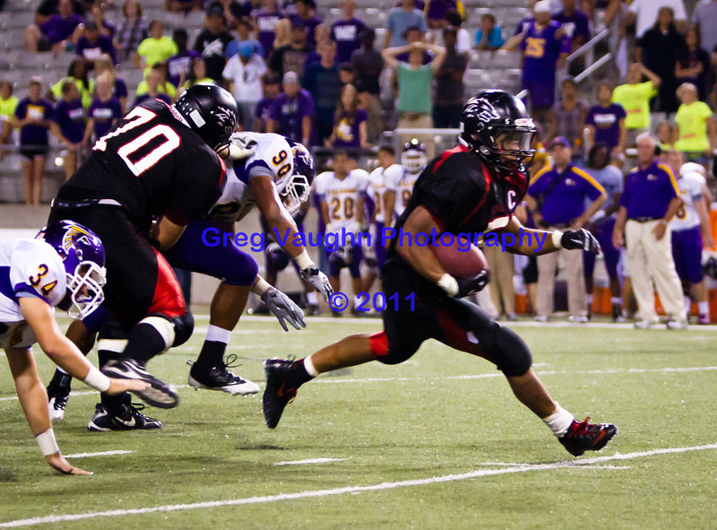 "Game: Langham Creek Lobos vs Jersey Village Falcons at Berry Center on Thursday, September 15, 2011<br /> <br /> Photo by Greg Vaughn.  Available at <a href=""http://www.gregvphotography.com"">http://www.gregvphotography.com</a>"