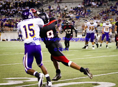 Langham Creek Lobos Junior DB Israel Giles intercepts a pass and returns it for a touchdown in 3rq quarter action to help trigger the Lobos come from behind victory.  This score made it 44 - 27 in favor of Cy-Ridge.  Game: Langham Creek Lobos vs Jersey Village Falcons at Berry Center on Thursday, September 15, 2011  Photo by Greg Vaughn.  Available at http://www.gregvphotography.com