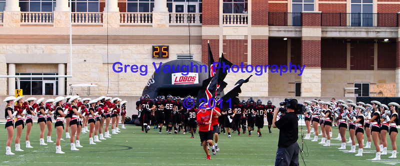 "The Langham Creek Lobos 2011 Varsity enters the field.<br /> <br /> Game: Langham Creek Lobos vs Jersey Village Falcons at Berry Center on Thursday, September 15, 2011<br /> <br /> Photo by Greg Vaughn.  Available at <a href=""http://www.gregvphotography.com"">http://www.gregvphotography.com</a>"
