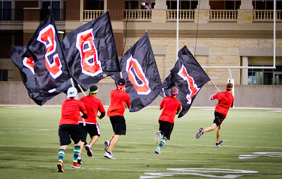 For the 9th time in a 66-28 win over Stratford, the LOBO flags make another run around the field.  Game: Langham Creek Lobos vs Stratford Spartans at Berry Center on Thursday, September 1, 2011  Photo by Greg Vaughn.  Available at http://www.gregvphotography.com