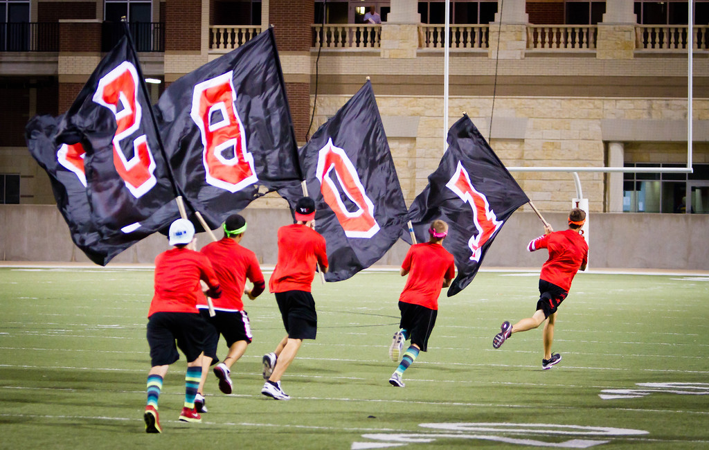 "For the 9th time in a 66-28 win over Stratford, the LOBO flags make another run around the field.<br /> <br /> Game: Langham Creek Lobos vs Stratford Spartans at Berry Center on Thursday, September 1, 2011<br /> <br /> Photo by Greg Vaughn.  Available at <a href=""http://www.gregvphotography.com"">http://www.gregvphotography.com</a>"