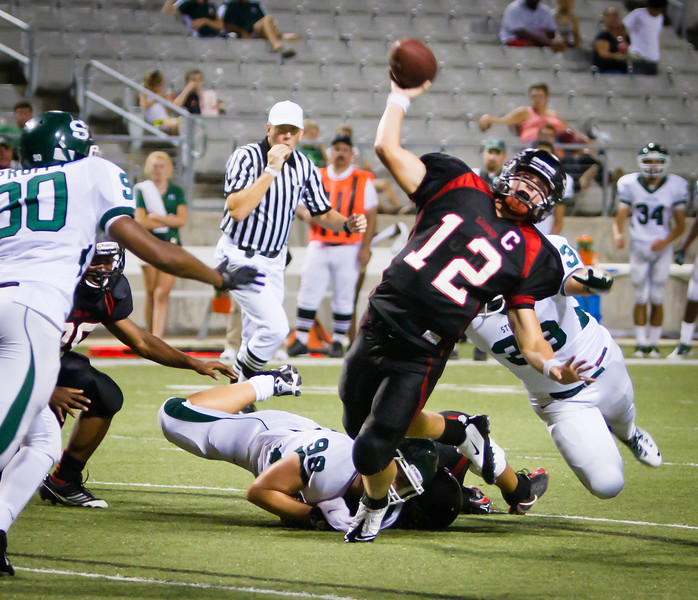 "Langham Creek Lobos Junior QB Connor Feist aims for the end zone as he is being brought down by the Stratford defense.<br /> <br /> Game: Langham Creek Lobos vs Stratford Spartans at Berry Center on Thursday, September 1, 2011<br /> <br /> Photo by Greg Vaughn.  Available at <a href=""http://www.gregvphotography.com"">http://www.gregvphotography.com</a>"