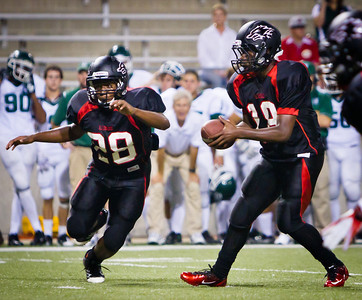 Backup QB Erik Derrow hands off to RB Jeremiah Williams as he's looking to break into the line.  Game: Langham Creek Lobos vs Stratford Spartans at Berry Center on Thursday, September 1, 2011  Photo by Greg Vaughn.  Available at http://www.gregvphotography.com