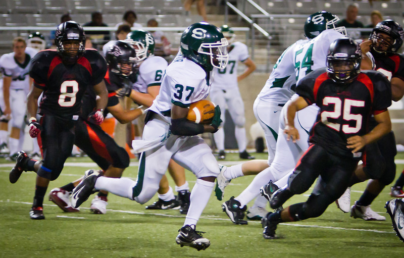 "LB Gabriel Aguilar closes in for a tackle with LB Brian Davis coming up to help.<br /> <br /> Game: Langham Creek Lobos vs Stratford Spartans at Berry Center on Thursday, September 1, 2011<br /> <br /> Photo by Greg Vaughn.  Available at <a href=""http://www.gregvphotography.com"">http://www.gregvphotography.com</a>"