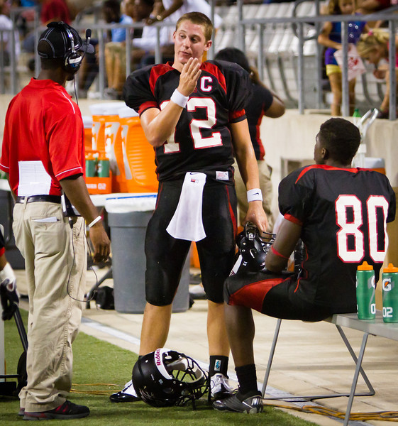 "QB Connor Feist discusses the last series of plays with his coach.<br /> <br /> Game: Langham Creek Lobos vs Stratford Spartans at Berry Center on Thursday, September 1, 2011<br /> <br /> Photo by Greg Vaughn.  Available at <a href=""http://www.gregvphotography.com"">http://www.gregvphotography.com</a>"