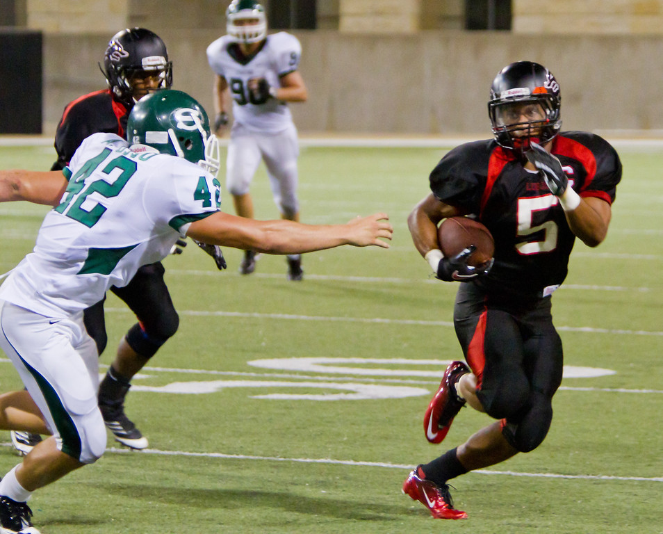 "RB Dillon Humphrey eludes another Spartan tackler.<br /> <br /> Game: Langham Creek Lobos vs Stratford Spartans at Berry Center on Thursday, September 1, 2011<br /> <br /> Photo by Greg Vaughn.  Available at <a href=""http://www.gregvphotography.com"">http://www.gregvphotography.com</a>"