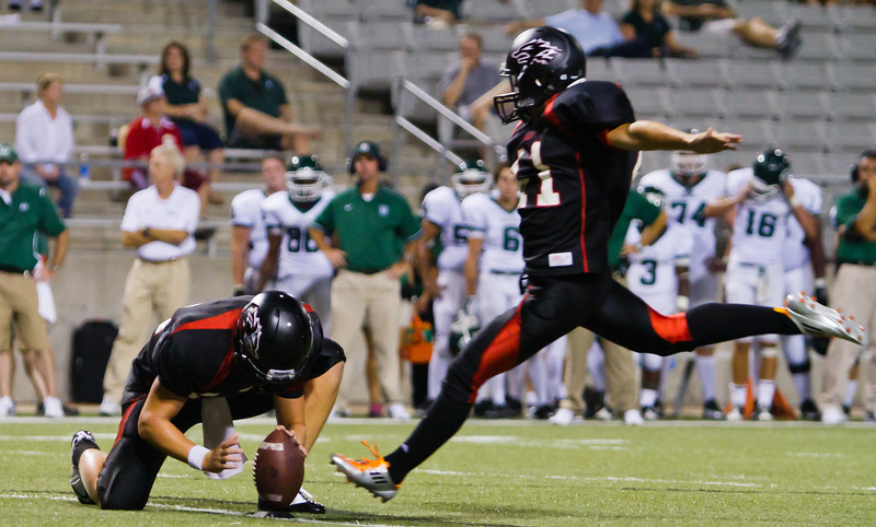 "Junior K Laith Tucker drives home another one of his 9 extra points.  He also kicked a field goal in this 66-28 win over Stratford.<br /> <br /> Game: Langham Creek Lobos vs Stratford Spartans at Berry Center on Thursday, September 1, 2011<br /> <br /> Photo by Greg Vaughn.  Available at <a href=""http://www.gregvphotography.com"">http://www.gregvphotography.com</a>"