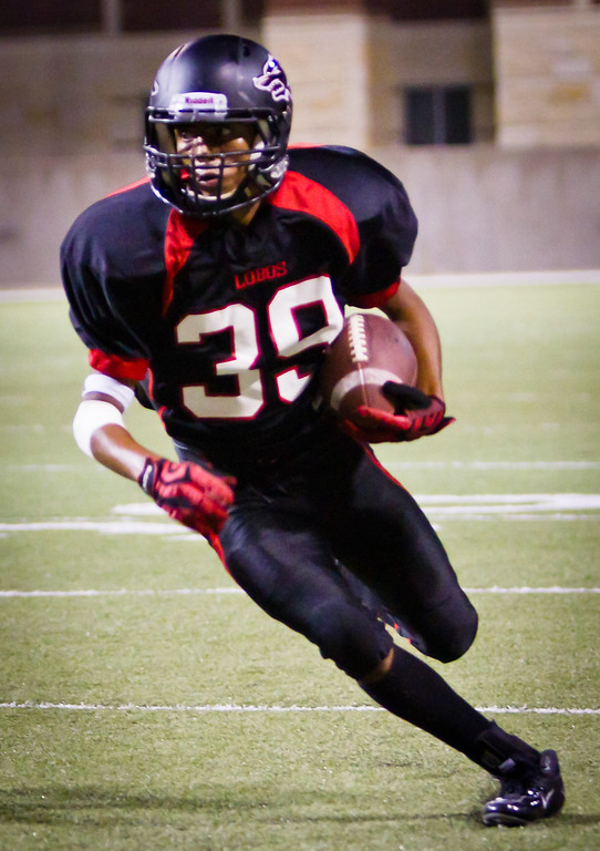 "Langham Creek Lobos WR Caleb Hobbs has a wide open field ahead after his reception in the 4th quarter.<br /> <br /> Game: Langham Creek Lobos vs Stratford Spartans at Berry Center on Thursday, September 1, 2011<br /> <br /> Photo by Greg Vaughn.  Available at <a href=""http://www.gregvphotography.com"">http://www.gregvphotography.com</a>"