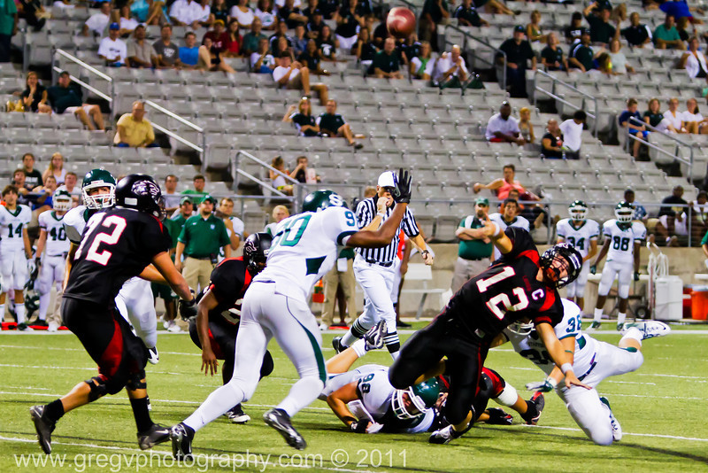 "Langham Creek Lobos Junior QB Connor Feist  launches a pass for the end zone as he is being tackled.<br /> <br /> Game: Langham Creek Lobos vs Stratford Spartans at Berry Center on Thursday, September 1, 2011<br /> <br /> Photo by Greg Vaughn.  Available at <a href=""http://www.gregvphotography.com"">http://www.gregvphotography.com</a>"