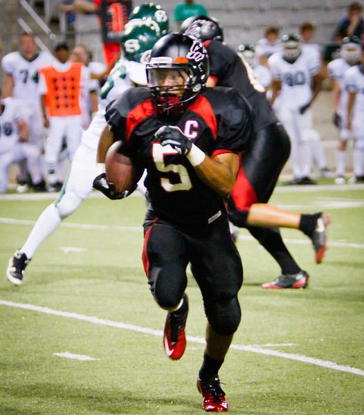 "RB Dillon Humphrey breaks free for another long gain.<br /> <br /> Game: Langham Creek Lobos vs Stratford Spartans at Berry Center on Thursday, September 1, 2011<br /> <br /> Photo by Greg Vaughn.  Available at <a href=""http://www.gregvphotography.com"">http://www.gregvphotography.com</a>"