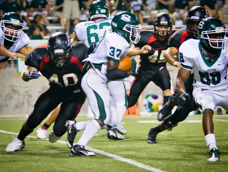 "DL Tarell Fulton closes on the Stratford running back.<br /> <br /> Game: Langham Creek Lobos vs Stratford Spartans at Berry Center on Thursday, September 1, 2011<br /> <br /> Photo by Greg Vaughn.  Available at <a href=""http://www.gregvphotography.com"">http://www.gregvphotography.com</a>"