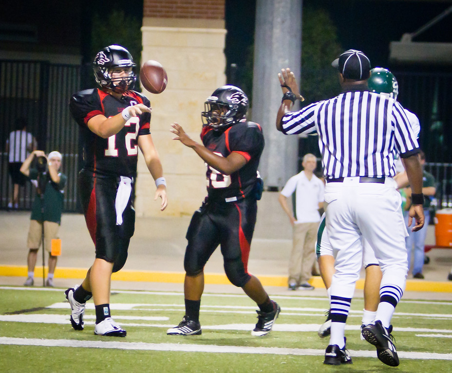 "QB Connor Feist finishes off another drive with a touchdown.  Langham Creek Lobos won this game by a final score of 66-28.<br /> <br /> Game:  Langham Creek Lobos vs Stratford Spartans at Berry Center on Thursday, September 1, 2011<br /> <br /> Photo by Greg Vaughn.  Available at <a href=""http://www.gregvphotography.com"">http://www.gregvphotography.com</a>"