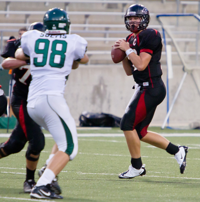 "QB Connor Feist drops back for a pass against the Stratford Spartans.<br /> <br /> Game: Langham Creek Lobos vs Stratford Spartans at Berry Center on Thursday, September 1, 2011<br /> <br /> Photo by Greg Vaughn.  Available at <a href=""http://www.gregvphotography.com"">http://www.gregvphotography.com</a>"