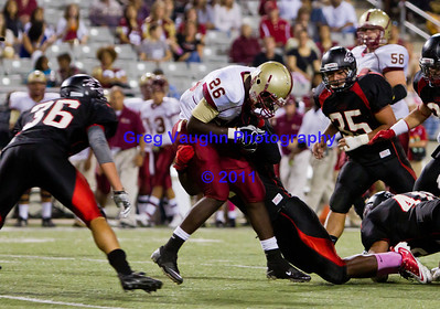 Game: Langham Creek Lobos vs Cy-Woods Wildcats at Berry Center on Friday, October 15, 2011  Photo by Greg Vaughn.  Available at http://www.gregvphotography.com