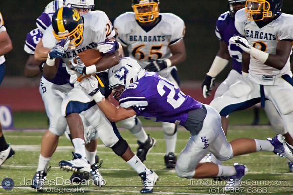 St. Francis DeSales High School's Joey Lyberger (12) and Chris Kurek (25) take down Brookhaven High School's Antonio Bell (22) in the second period of play at St. Francis DeSales High School Friday night September 2, 2011. (©2011 James D. DeCamp   614-367-6366   http://www.JamesDeCamp.com)