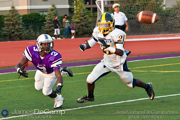 St. Francis DeSales High School's Marq Pannell (3) looks for the pass as Brookhaven High School's Damion Mayhorn (21) closes in for the tackle in the first period of play at St. Francis DeSales High School Friday night September 2, 2011. (©2011 James D. DeCamp   614-367-6366   http://www.JamesDeCamp.com)