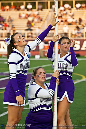 (l-r) St. Francis DeSales High School's Christy Lodder, Steffany Morse, and Emily Iwaszkiewicz hold up a banner for the football team at the start of their game against Brookhaven High School at St. Francis DeSales High School Friday night September 2, 2011. (©2011 James D. DeCamp   614-367-6366   http://www.JamesDeCamp.com)
