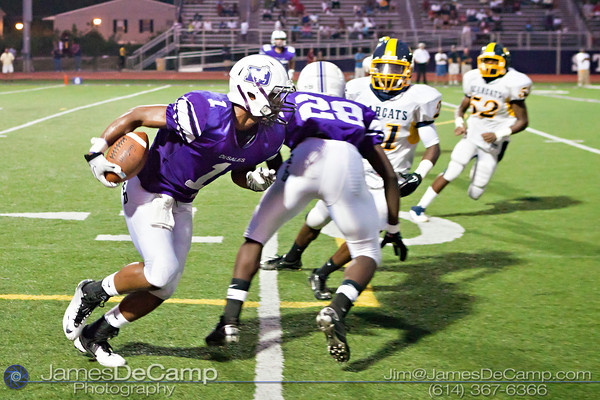 St. Francis DeSales High School's Charles Chandler (1)  looks for clean turf as teammate Sayyid Kanu (28) fends off Brookhaven High School tacklers in the second period of play at St. Francis DeSales High School Friday night September 2, 2011. (©2011 James D. DeCamp   614-367-6366   http://www.JamesDeCamp.com)