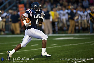 Bishop Hartley High School's JaWaun Woodley (4) makes major yardage in the first quarter of play against the Akron Hoban Knights Friday night September 16, 2011 at Bishop Hartley High School.