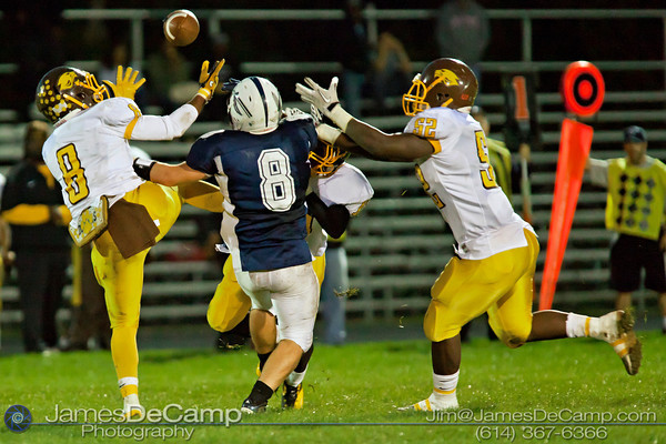 Beechcroft High School's Shaquille Minnifield (8), left, Adonis Davis (52), right,  Landers Cox (13) rear, and Whetstone High School's Kyle Radabaugh (8) vie for a loose pass intended for Radabaugh in the first quarter of play at Whetstone High School Friday night September 23, 2011.