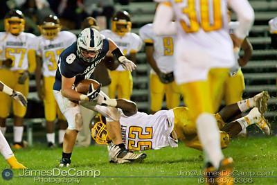 Beechcroft High School's Adonis Davis (52) brings down Whetstone High School's Kyle Radabaugh (8) in the first quarter of play at Whetstone High School Friday night September 23, 2011.