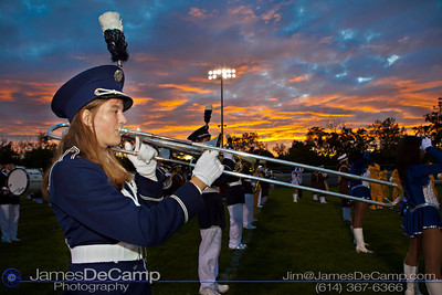 Whetstone High School's Julia Weaver plays the national anthem in front of a setting sun before her schools football game against Beechcroft High School's (##) in the first quarter of play at Whetstone High School Friday night September 23, 2011.