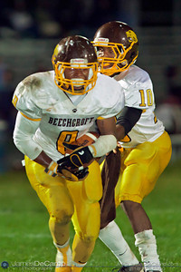 Beechcroft High School's Shaquille Minnifield (8) takes a hand off from Maurice Hale (10) against Whetstone High School in the second quarter of play at Whetstone High School Friday night September 23, 2011.