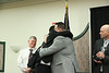 Coach O'Connell hugs and congratulations Kurt Massey from John Bapst HS.