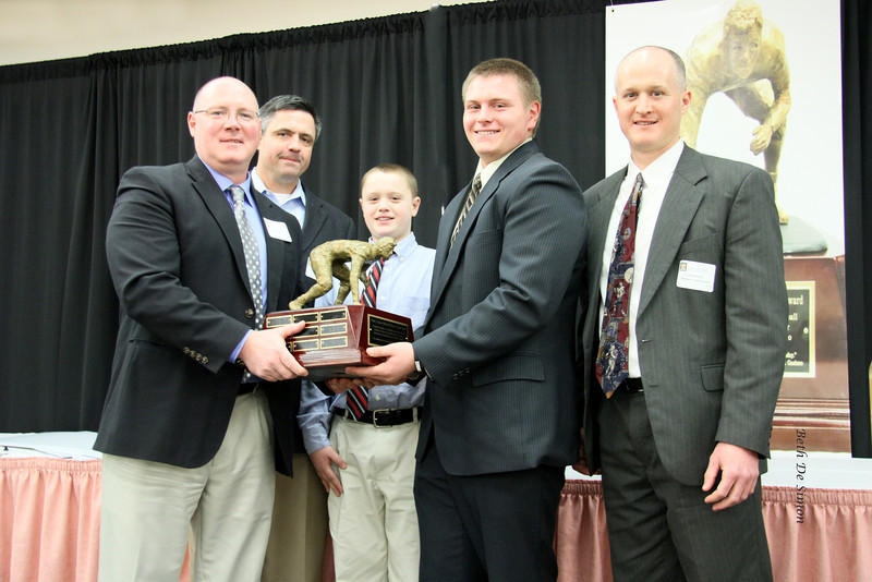 Logan Mars', Dad Chris and Brother Nathan along with Scarborough HS Coach Johnson pass the Traveling Trophy along to Bobby Begin and Coach Kenzal from Thornton Academy.