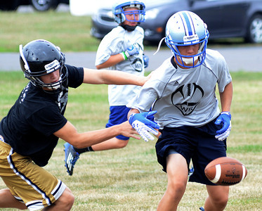 Southern Columbia's Blake Marks and Warrior Run's Zach Miller race for the ball during their game Saturday July 14, 2012 at the Cental Columbia 7 on 7 tournament.