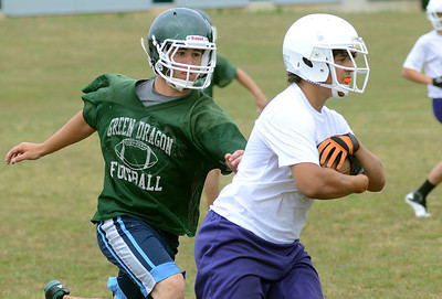 Lewisburg's Michael Berger chases down Danville's Isaac Troutman during the Central Columbia 7 on 7 tournament Saturday July 14, 2012.