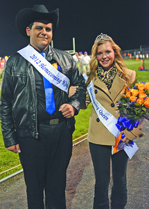 Benji Game, 17 of Danville son of Peggy and Edward Game, and Kylie Gorki, 17 of Danville daughter of Nevin and Robin Gorki, are crowned Danville High School's Homecoming King and Queen on Friday night during half-time of the football game against Jersey Shore, which Danville won 42-14.