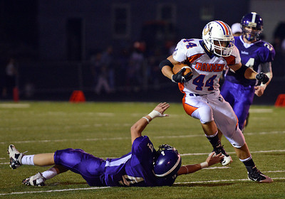 Amanda August/For The Daily Item Danville Area High School's Isaiah Croll (44) attempts to dodge Shamokin Area High School's Johnny Demsko (4) during their 20-10 win over Shamokin on Friday night in Shamokin.