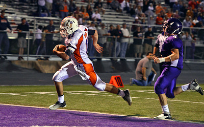 Amanda August/For The Daily Item Danville Area High School's Weston Baylor (11) scores a touchdown during the game against Shamokin Area High School on Friday night in Shamokin. Danville won 20-10.
