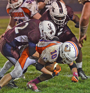 Danville Ironmen's Cale Rice is taken down by the Shikellamy Braves after catching an interception during Danville's 24-0 win on Friday night in Sunbury.