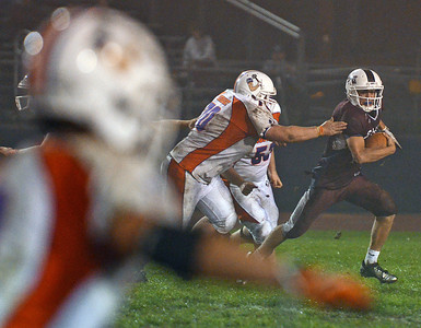 Shikellamy Brave Garrett Kemberling runs the ball during the football game against Danville Ironmen on Friday night in Sunbury.
