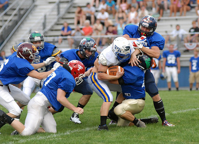South's Kyle Troutman of Line Mountain fight to free himself from a gang of Noth players during the District IV All-Star Football game in South Williamsport Friday June 29, 2012.