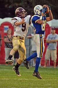 Amanda August/For The Daily Item Line Mountain's Jeremy Renn (85) catches the pass meant for Millersburg's Connor Keim (9) for an interception during the football game on Friday night. Line Mountain won 38-0.