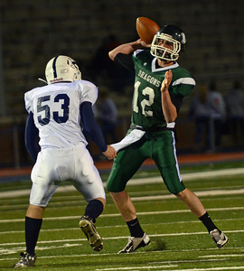 Lewisburg Green Dragons' Quarterback Nicola Costagliola looks to throw the ball during the football game against Mifflinburg Wildcats on Friday night at Bucknell University.