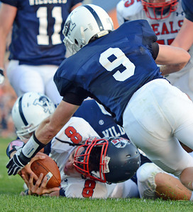 Amanda August/For The Daily Item Selinsgrove High School's football player Tyler Krebs (8) attempts to place the ball over the goal line during the 3-0 win over Mifflinburg High School on Friday night in Mifflinburg.