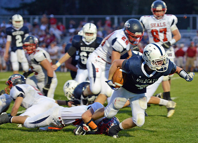 Amanda August/For The Daily Item Mifflinburg High School's Dustin Mertz (4) attempts to get past the defense of Selinsgrove High School on Friday night during the football game in Mifflinburg. Selinsgrove won 3-0.