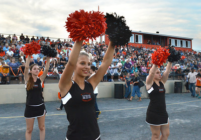 Milton's Krysta Hettinger supports her team with fellow cheerleaders during their game against Warrior Run Friday Sept. 7, 2012.