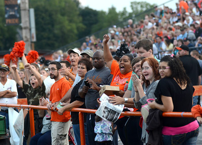 Milton fans cheer on their team after an early touchdown in their game against Warrior Run Friday Sept. 7, 2012.