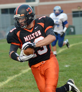 Milton's Grant Wargo runs the ball into the end zone during the first quarter of their game against Warrior Run Friday Sept. 7, 2012.