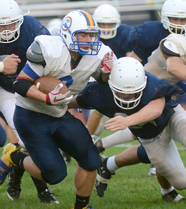 Line Mountain's Jeremy Renn braces for a tackle by Shikellamy's Jesse Shambach during their pre-season scrimmage Friday night Aug. 24, 2012 in Sunbury.