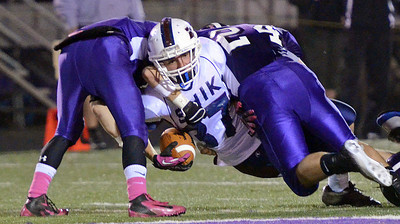 Shikellamy Braves' Tyler Leib is brought down by Shamokin Indians' defense on Friday night in Shamokin.