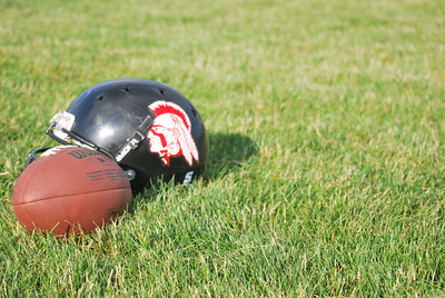 Amanda August/For The Daily Item A football and a helmet of the Susquehanna Valley Seminoles sits on the sidelines of their practice on Friday night in Northumberland.